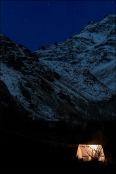 A view of our camp site by night in the shadow of the Himalayas.
