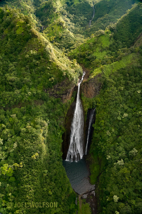 Aerial of a large waterfall on the island of Kauai. It's often necessary to use high shutter speeds from a helicopter- when combined with a polarizing filter and exposing for the shade you can end up with commensurately high ISO even in daylight. The Sony A7R II handles it with aplomb! Here I used 1/800 sec, f9.0 at ISO 10,000.