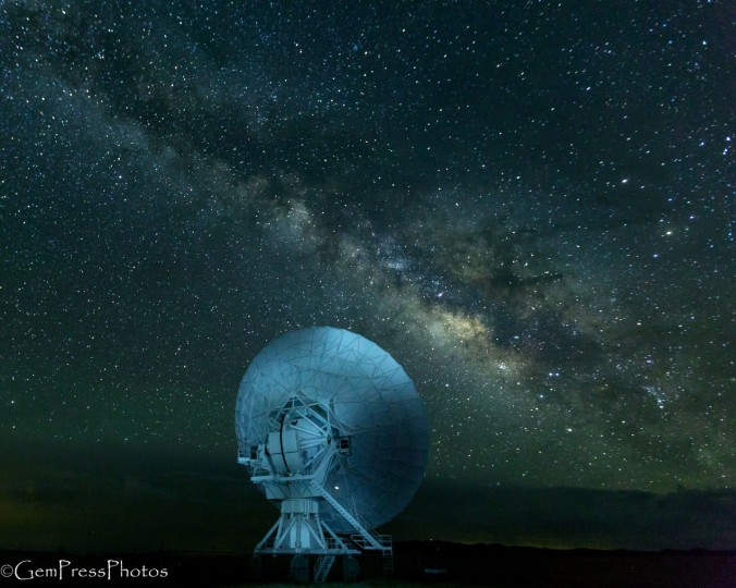 Radio telescope dish, lit by flashlight pointed toward the Milky Way at the eastern end of the VLA