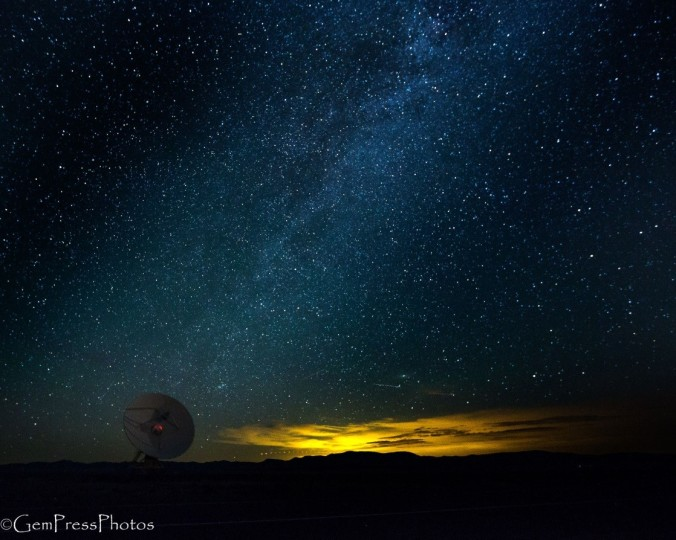The lights of Albuquerque in the distance at the northern extent of the milky way and the dish for context.